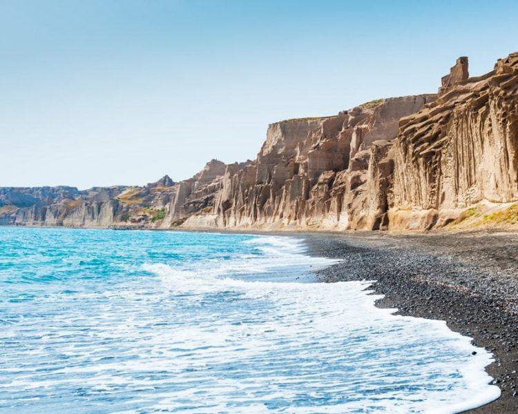 Beautiful-beach-with-volcanic-mountains-and-turquoise-water.-Vlychada-beach-Santorini-island-Greece-min